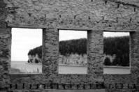 Limestone Cliffs Through Brick