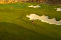 Felame Golfer Approaching the green