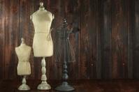 Old Antique Busts on Wood Grunge Background
