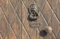detail brown lion faced handle door knocker Cyprus