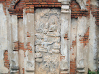 Buddhism Thai stucco on the stone wall, Thailand