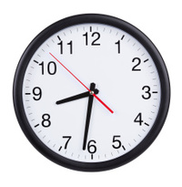 Office clock shows half of the ninth