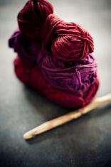 Crochet Hook And Balls Of Yarn