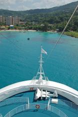 Cruise ship facing exotic island