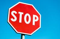 Stop roadsign against sky