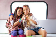 two gipsy girls showing a heart shape