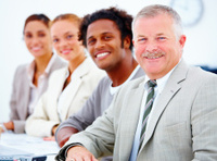 Closeup portrait of a smiling business man with executives