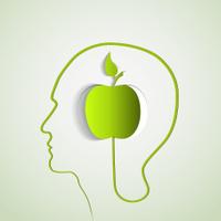 Human head profile with green apple