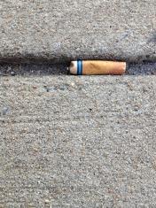 Cigarette Butt on Sidewalk
