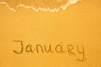 January - written in sand on beach