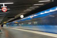 Blurred metro train departing underground station