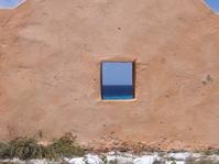 Red slave hut window in Bonaire