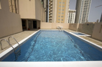 man in swimming pool at roof