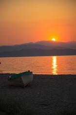 Wooden Boat Sitting on Golden Sand Beach