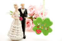 Luck cloverleaf and bride pair with roses