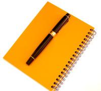 yellow agenda and pen