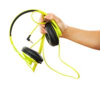 woman hand holding yellow headphone on white