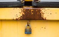 yellow locked dumpster