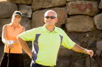 Confident Senior Golfer Wearing Sunglasses