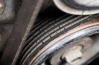 Cracked Serpentine Belt on Vehicle Engine Pulley
