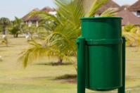 green trashcan on summer resort i