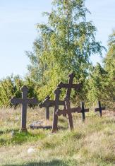 Metal crosses at graveyard