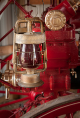 Red Lantern Hangs on 1876 Fire Engine