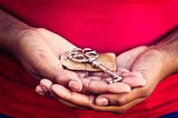 Female Hands Holding Vintage Key