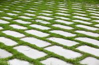 Brick and grass ground