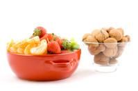 Kiwi, strawberry and mandarine, tangerine with mixed nuts