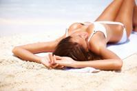 Sexy woman lying on beach