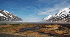 Iceland summer landscape. Fjord, house, mountains