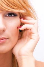 Beautiful blonde woman facing camera, half-face