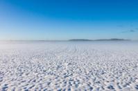 Winter foggy field under snow