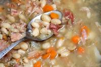 Spoon  in bean soup.