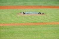 Covered baseball mound in offseason