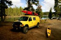 Yellow Van and kayaks