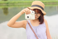 Portrait women taking photography