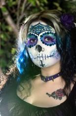 Outdoor, side lit sugar skull portrait.
