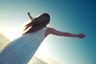 Joyful woman at sunrise