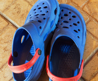Blue plastic slippers