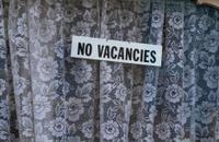 No vacancies sign in window