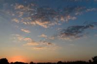 Dramatic nature image with horizon line at sunset