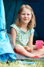 Girl Having Snack On Camping Trip