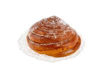 bun on a white napkin with powdered sugar