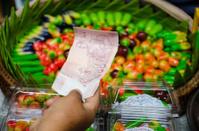 hand hold money for buy dessert in thailand
