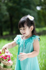 Little girl with flower basket