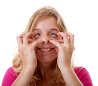 girl makes funny face in closeup