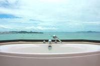 Bathtub in restroom on sea view background