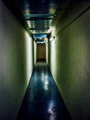 Spooky narrow underground corridor